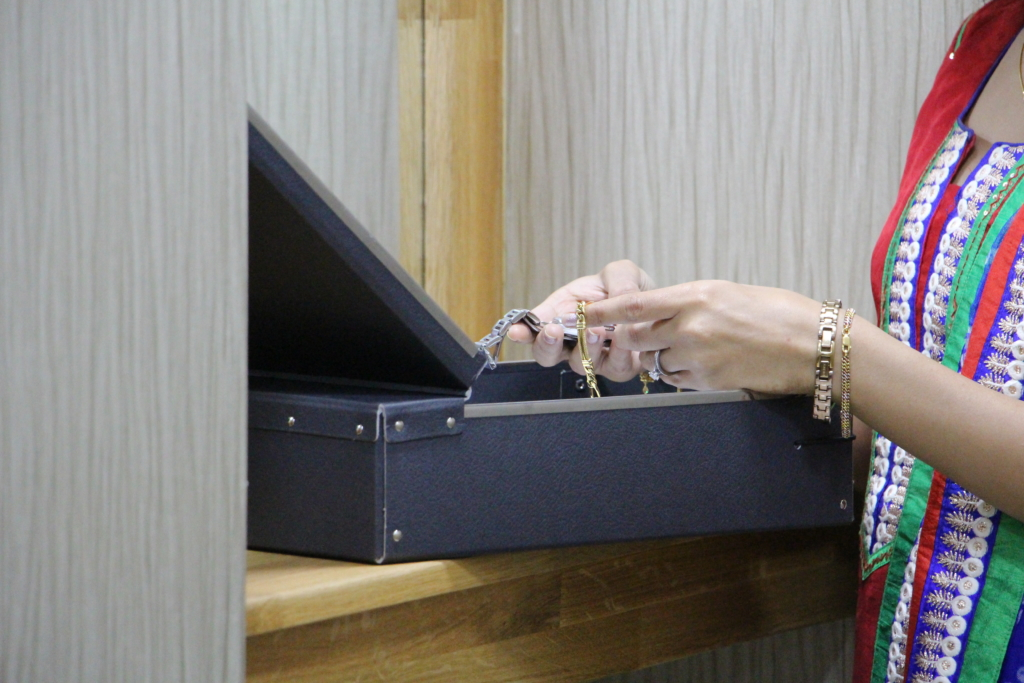 Lady removes valuables from box in private viewing room